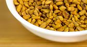 stock photo of fenugreek  - Macro closeup of fenugreek in white bowl - JPG