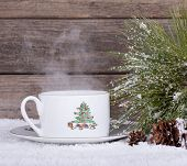 pic of pine-needle  - Steaming Christmas cup with pine needles on a wooden background - JPG