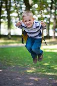 pic of swing  - Cute little blond boy swinging on swings - JPG