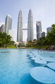 KUALA LUMPUR, MALAYSIA, JULY 5: Park with fountains at Petronas towers in the city centre. Designed by the brazilian landscape artist, the late Roberto Burle Marx.