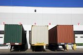 stock photo of oversize load  - Colorful Trailers in front of the warehouse - JPG