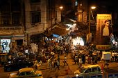 KOLKATA, INDIA - FEB 10: Dark city traffic blurred in motion at late evening on crowded streets on February 10, 2014 in Calcutta. Kolkata has a density of 814.80 vehicles per km road length