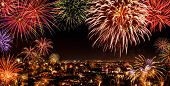 picture of firework display  - Whole city celebrating the New Year or any national event with delightful fireworks copyspace on the night sky - JPG