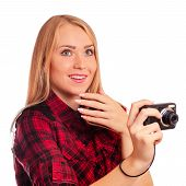 stock photo of humiliation  - Attractive female photographer holding compact camera and humiliating it  - JPG