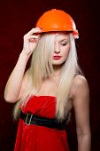 Portrait Of A Young Girl In A Helmet Of The Builder