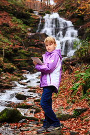 picture of grils  - Little artist gril with sketch in note at autumn landscape - JPG