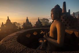 pic of arjuna  - Borobudur Temple at sunrise Yogyakarta Java Indonesia. (silhouette scene)