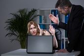 stock photo of inappropriate  - Young pretty employee and her boss - JPG
