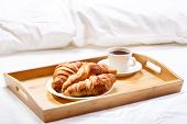 picture of bed breakfast  - breakfast in bed with coffee and croissants - JPG