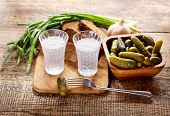 picture of vodka  - glasses of vodka with various snack on wooden table - JPG