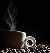 stock photo of coffee crop  - Cup of coffee with smoke and coffee beans on black background - JPG