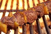 stock photo of bbq party  - Beef Kebabs On The Hot BBQ Grill Closeup - JPG