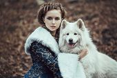 picture of blue animal  - The woman in blue coat walk with a dog - JPG