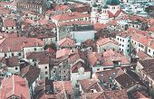 stock photo of upside  - The view over red tiles roofs of the old center of Kotor Montenegro from the ancient fortress wall upside the mountain - JPG