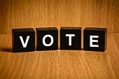 image of voting  - Vote text on black block - JPG