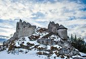 stock photo of ashes  - Medieval ashes of the Ehrenberg castle in Tirol Alps Austria on a clear winter day - JPG