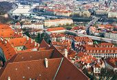 foto of nasty  - The view over the red roofs of Prague and the Vltava riverfrom the tower of the aint Vitus Cathedral on a nasty day - JPG