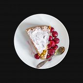 picture of cherry pie  - A piece of custard cherry pie on a white ceramic dessert plate on a black background - JPG