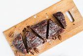 stock photo of pecan  - Pecan brownie cake on a wooden board - JPG