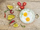 foto of pesto sauce  - Breakfast set with roasted eggs bread toasts with pesto sauce cherry - JPG