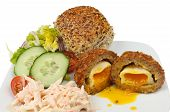 picture of bread rolls  - Closeup of runny yolk scotch egg salad and bread roll on a plate - JPG