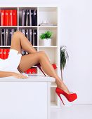 image of thigh highs  - legs of sexy businesswoman lying on table at office - JPG