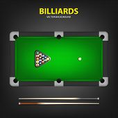 stock photo of realism  - Billiard balls in triangle and two cues on a pool table - JPG