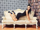 stock photo of provocative  - young provocative woman on couch at home - JPG