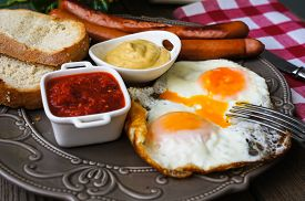 stock photo of pommes de terre frites  - Lunch time with eggs and fried sausages - JPG