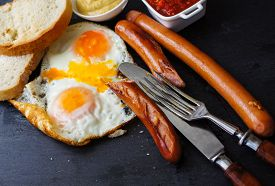 pic of pommes de terre frites  - Lunch time with eggs and fried sausages - JPG