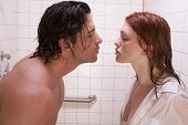 image of early 20s  - Loving affectionate nude young heterosexual couple in affectionate sensual kiss after taking shower - JPG