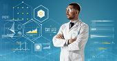 medicine, science, healthcare and people concept - male doctor or scientist in white coat and safety poster