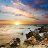 pic of beach sunset  - Sea and rock at the sunset - JPG