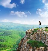 stock photo of mountain-high  - Girl on the peak of mountain - JPG