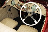 picture of mg  - vintage sports car cockpit including steering wheel and dials - JPG