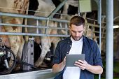 agriculture industry, farming, people, technology and animal husbandry concept - young man or farmer poster