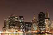 Lowre Manhattan Skyline At Night From Brooklyn, New York City