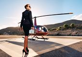 Elegant Business Woman Near The Helicopter. poster