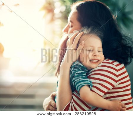 poster of Happy mother's day! Mom and her daughter child girl are playing, smiling and hugging. Family holiday