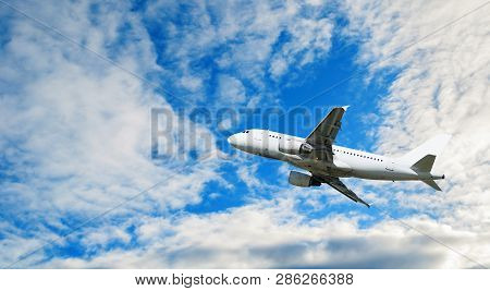 poster of Airplane flying in the sky - travel background. Flying airplane, concept of air travel, commercial airplane in the flight. White flying airplane, travel concept