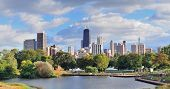 stock photo of illinois  - Chicago skyline with skyscrapers viewed from Lincoln Park over lake - JPG