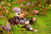 A Garden Is A Grand Teacher. Small Child Relax In Garden. Small Child Enjoy Flowers Blossoming In Ga poster