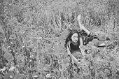 Woman Writer In Poppy Flower Field. Woman Writer With Typewriter In Poppy Field poster