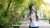 Confident Asian Man University Student With Glasses And Headphones Smiling And Holding Backpack In T poster