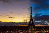Night To Day Transition Over Eiffel Tower In Winter From Trocadero On A Cloudy Day - Paris, France. poster