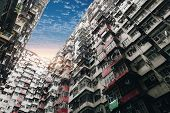 Looking Up At Old Building To Sky In Perspective View At Sunset, Hongkong. Old Tall And Dense Reside poster