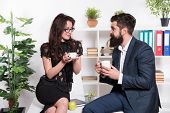 Man And Woman Pleasant Conversation During Coffee Break. Discussing Office Rumors. Ask For Recommend poster