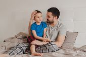 Portrait Of Middle Age Caucasian Father Talking To Boy Son. Male Man Parent Holding Hugging With Chi poster