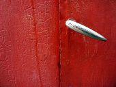 Red Handle On Metal Door.