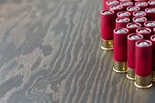 stock photo of shotgun  - 12 gauge shotgun shells on a wooden surface.